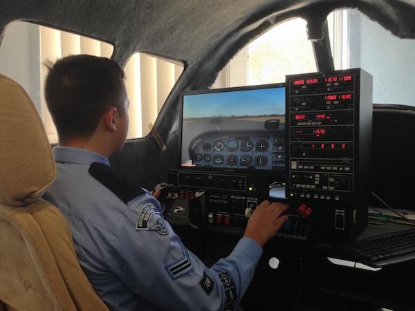 A cadet practises on the flight simulator