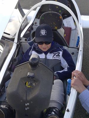 A young cadet enjoying air experience flight