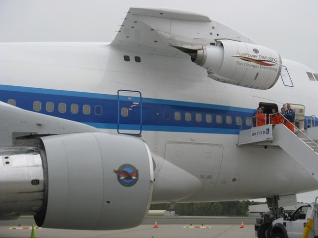 Can you spot what is different about this Boeing 747-100? If you guessed the engine attached to the upper deck -- you win. Pratt & Whitney is testing the PW1200G engine. Photo by Guy Norris.