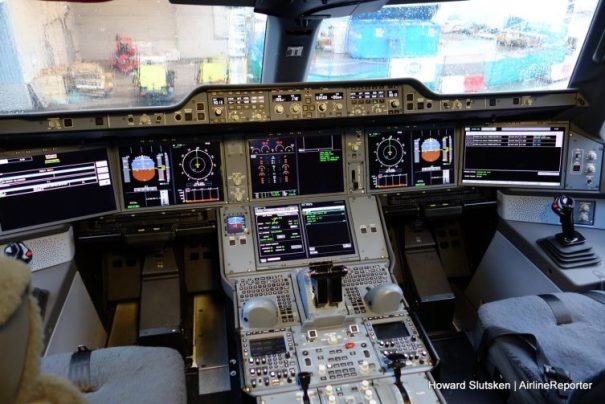 The advanced flight deck of Cathay Pacific's A350, B-RLI, at the gate at YVR