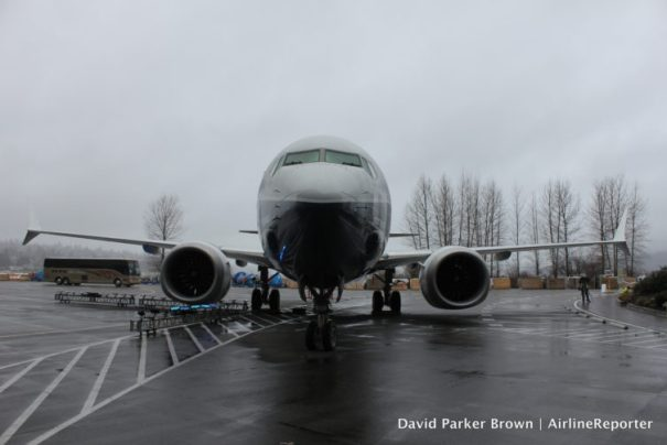 The aircraft almost blends into the gray Seattle skies.