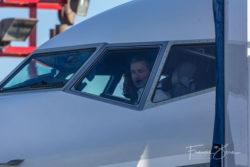 Flight crew prepare the plane for takeoff.