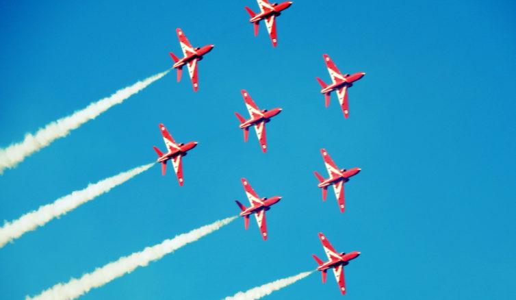 Red Arrows performing their trademark Diamond Maneuver.