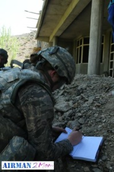 Taking notes during a site visit at a school in Nijrab, Kapisa, Afghanistan