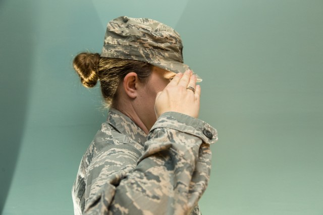 women of the military salute