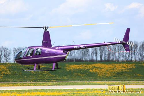 PH-HCA Robinson R44 Raven II (voor de metamorfose, 4 mei 2013)