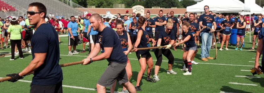 airrosti employees competing in tug of war competition
