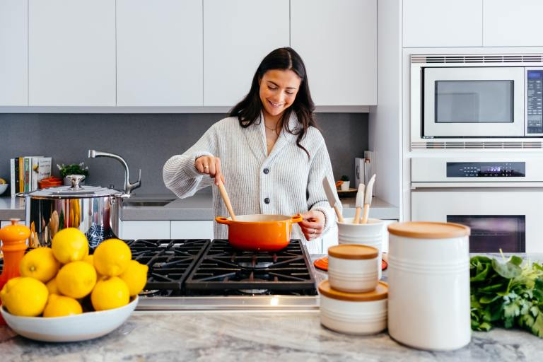 Woman Stirring a Pot in a Kitchen