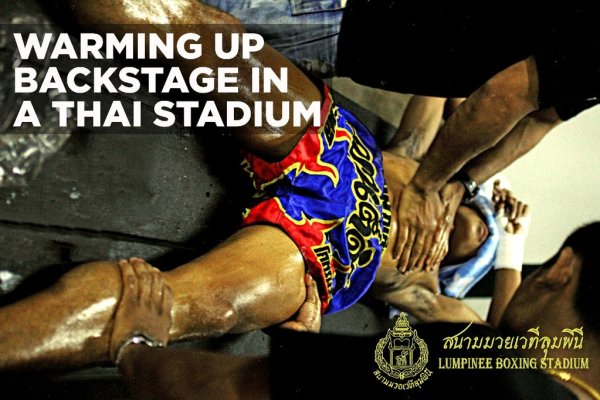 Photo of Boxer being massaged at Lumpinee Stadium Bangkok, Thailand by Jacob Klensin