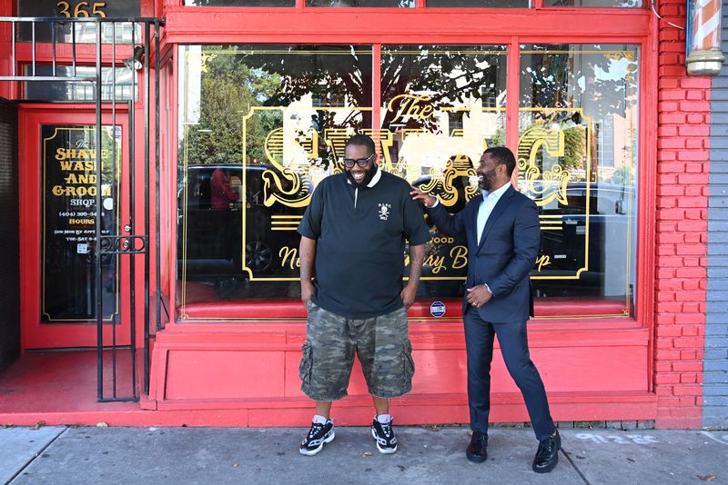 Mike Render and Ryan Glover, who are opening a digital bank aimed at communities of color, outside Render's Swag Shop barber shop in Atlanta on Tuesday, October 6, 2020. (Hyosub Shin / Hyosub.Shin@ajc.com)