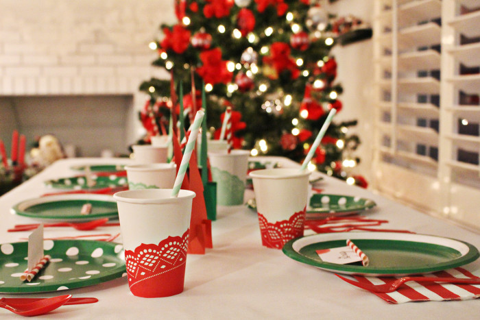 A playful red and mixed green Christmas dinner table from a joyful riot