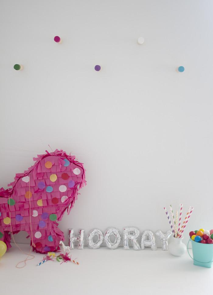 DIY colorful dowel wall hooks | A Joyful Riot