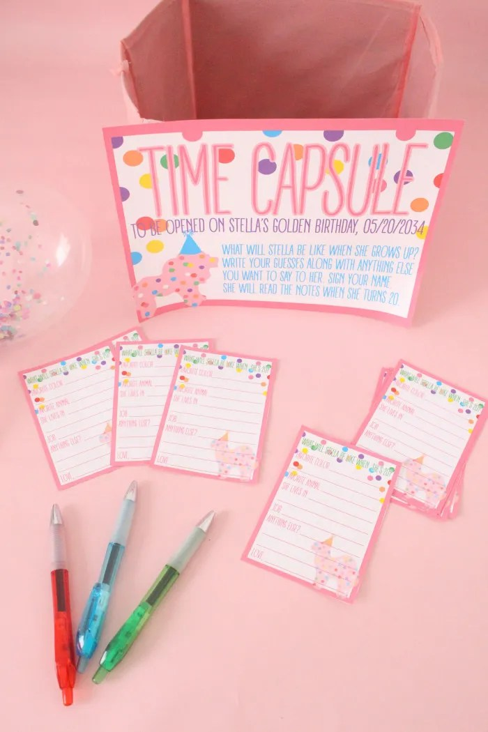 Cute and fun idea for your baby's first year birthday party! Time capsule where everyone guesses what they'll be like when they grow up | A Joyful Riot