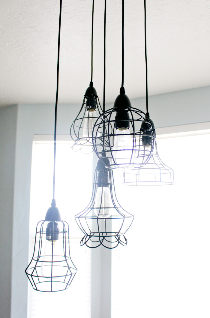 Awesome multi cage pendant light chandelier with vintage edison bulbs | A Joyful Riot