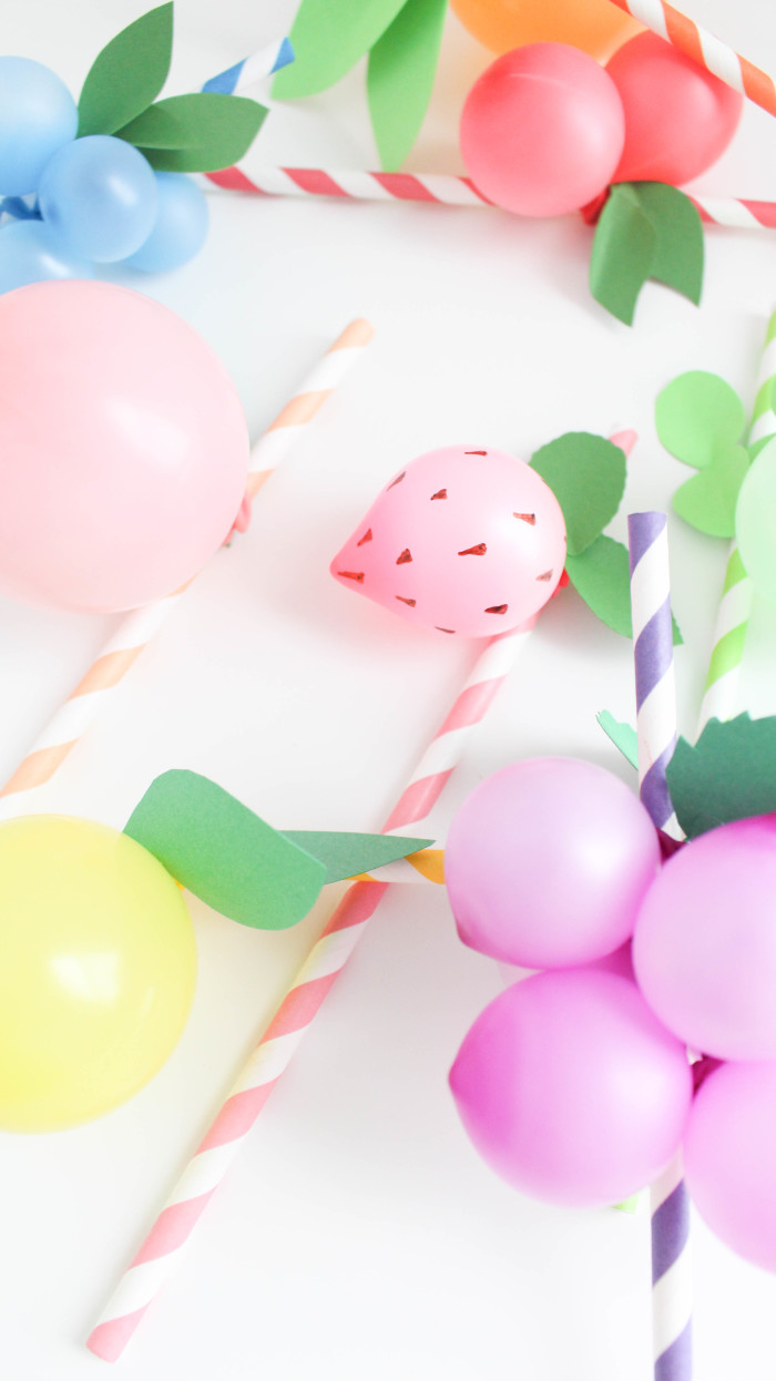 Sweet and colorful fruit balloon straws for your summer parties! Lemons, limes, pineapples, strawberries, cherries, peach, orange, grapes, blueberries! via A Joyful Riot-2