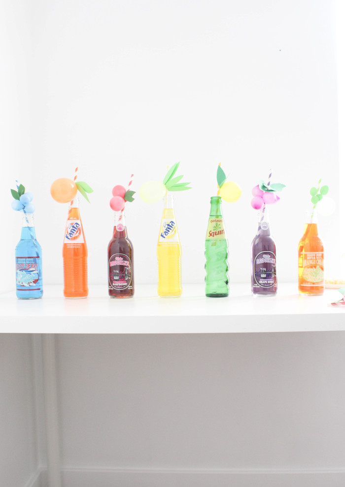 Sweet and colorful fruit balloon straws for your summer parties! Lemons, limes, pineapples, strawberries, cherries, peach, orange, grapes, blueberries! via A Joyful Riot-47