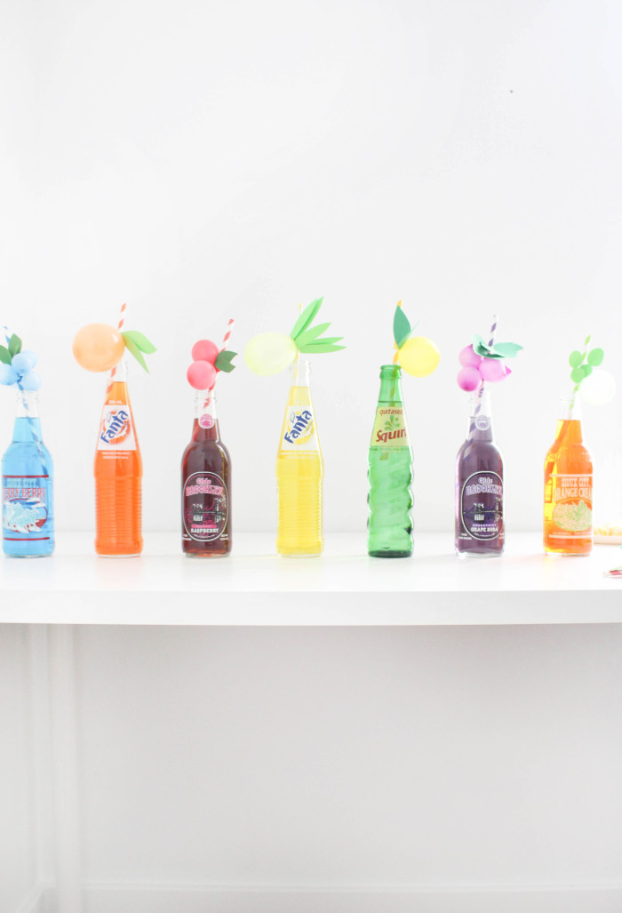 Sweet and colorful fruit balloon straws for your summer parties! Lemons, limes, pineapples, strawberries, cherries, peach, orange, grapes, blueberries! via A Joyful Riot-48