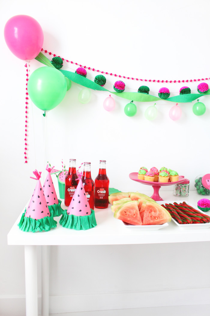 Free printable party hats that look like little watermelon wedges! Perfect for a watermelon themed party or a BBQ | A Joyful Riot