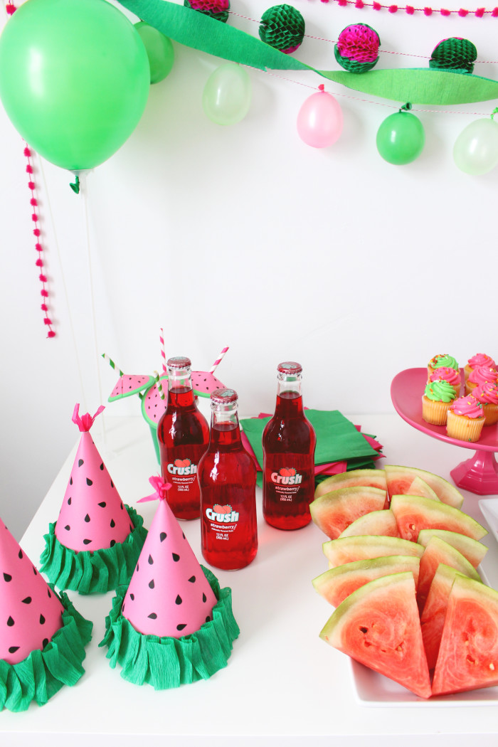 Free printable party hats that look like little watermelon wedges! Perfect for a watermelon themed party or a BBQ   A Joyful Riot