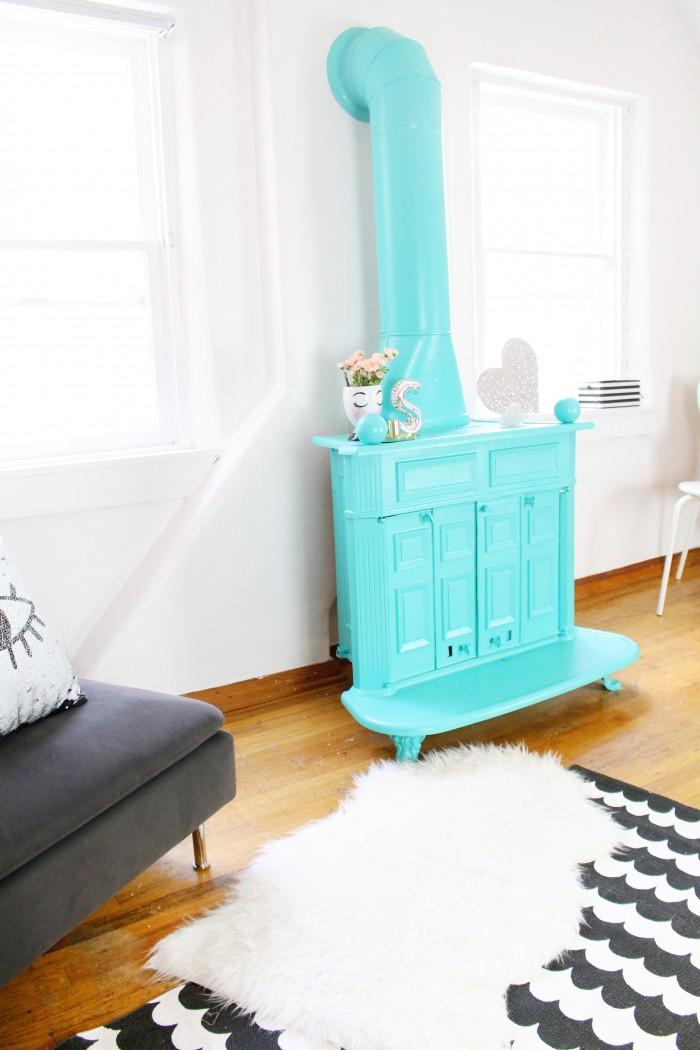 Awesome turquoise wood burning stove, painted vintage fireplace