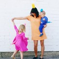 family balloon animal costumes DIY orange pink blue dogs