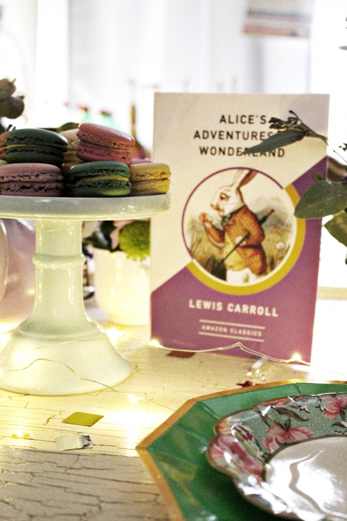 various versions of Alice in Wonderland books throughout the tables and centerpiece