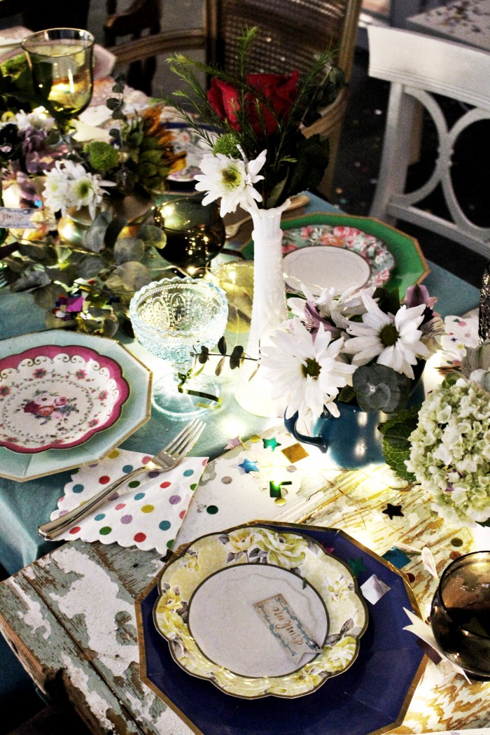 mixed colored glass cups, truly scrumptious truly alice plates, gold utensils, teapot centerpiece
