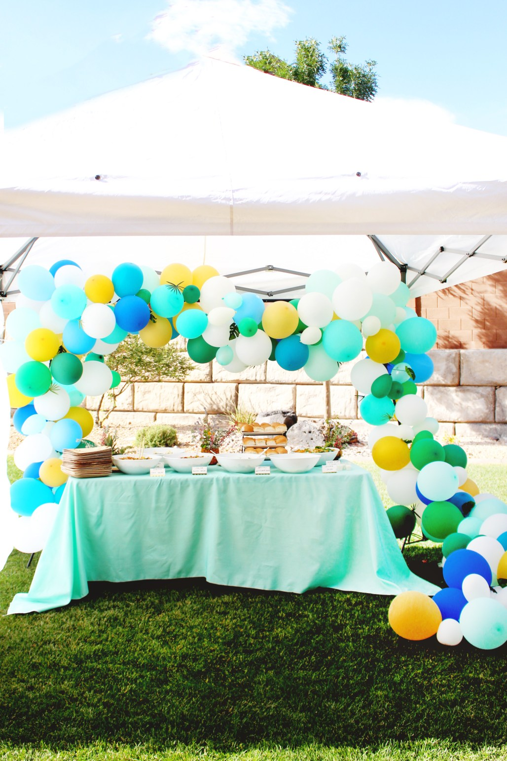 Modern Tropical 80th Birthday Party with palm leave balloon arch