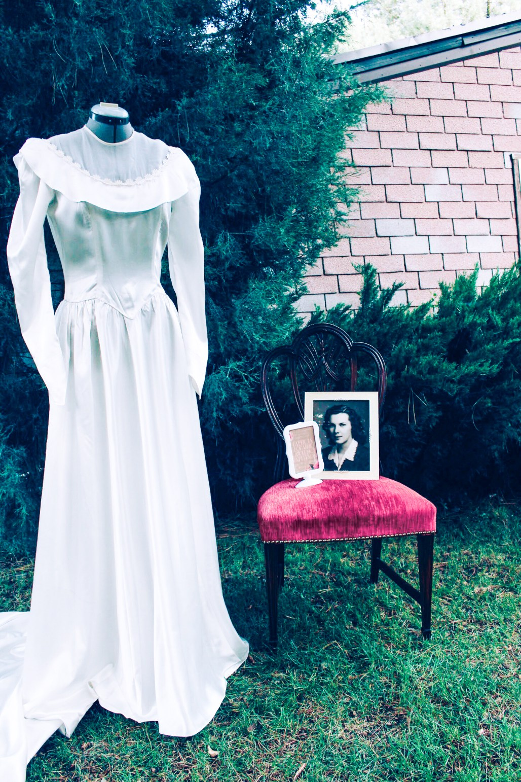 Display a mother's or grandmother's wedding dress at a bridal shower for a nostalgic touch. Pink and rose gold bridal shower with vintage elements.