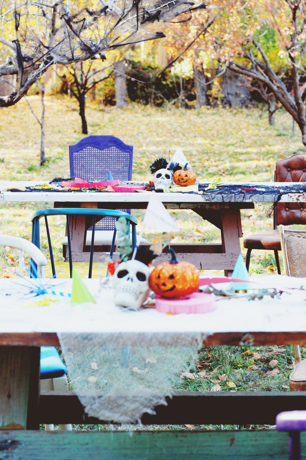 halloween carnival birthday party mixed vintage chairs and pops of color