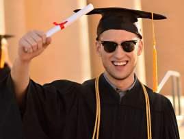 Graduation-photos-guy-with-diploma