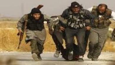 """صورة انهيار نقاط مرابطة """"داعش""""الارهابي الخلفية في معسكر الغزلاني بالموصل"""