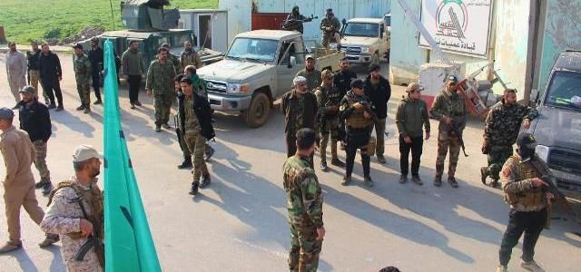 بالصور.. الحشد الشعبي،يمنع قوة أمريكية من التجوال في الموصل