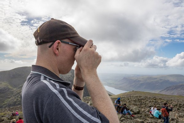 Pete taking photograph from Scafell Pike Summit