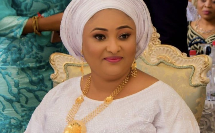Check out the First Lady of Kogi State Looking Glamorously Cute In Her White Outfit