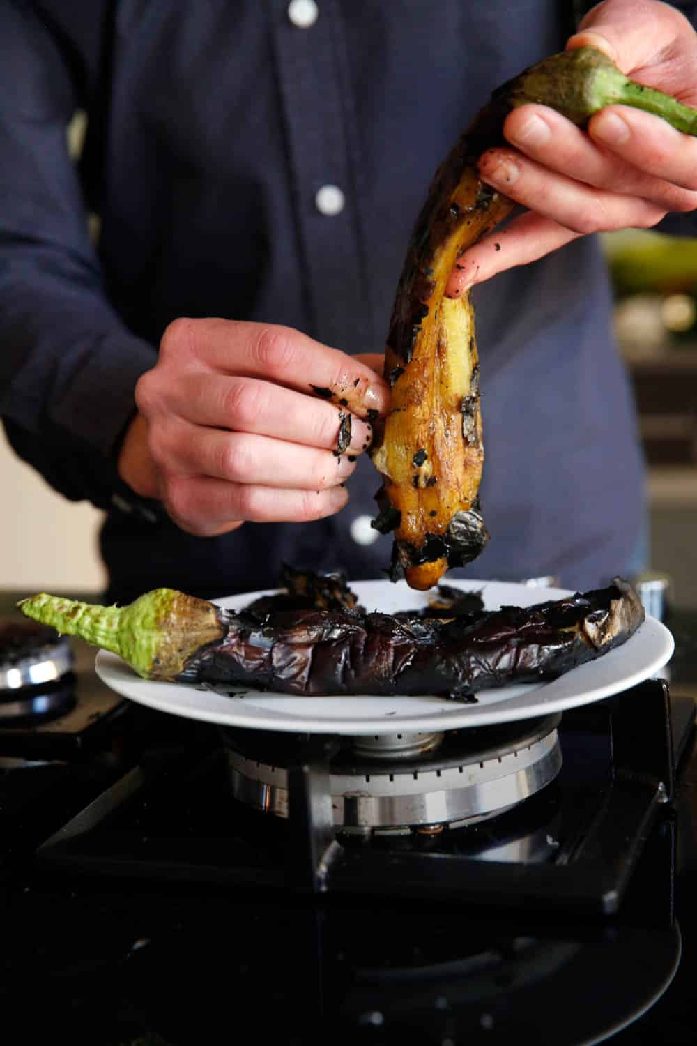 Burning and peeling aubergine / A kitchen in Istanbul