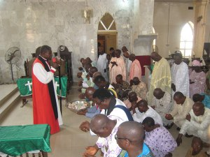 Bishop-praying-for-the-fathers