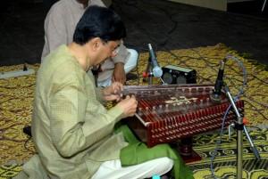 Shri snehal Majumdar playing santoor