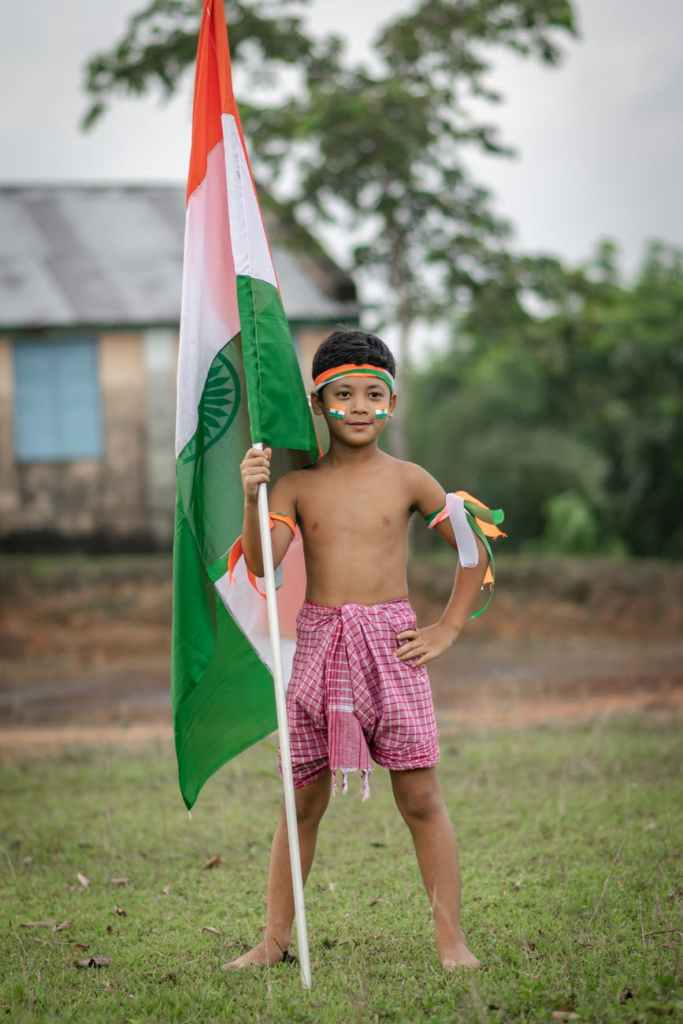 boy holding a flag of india