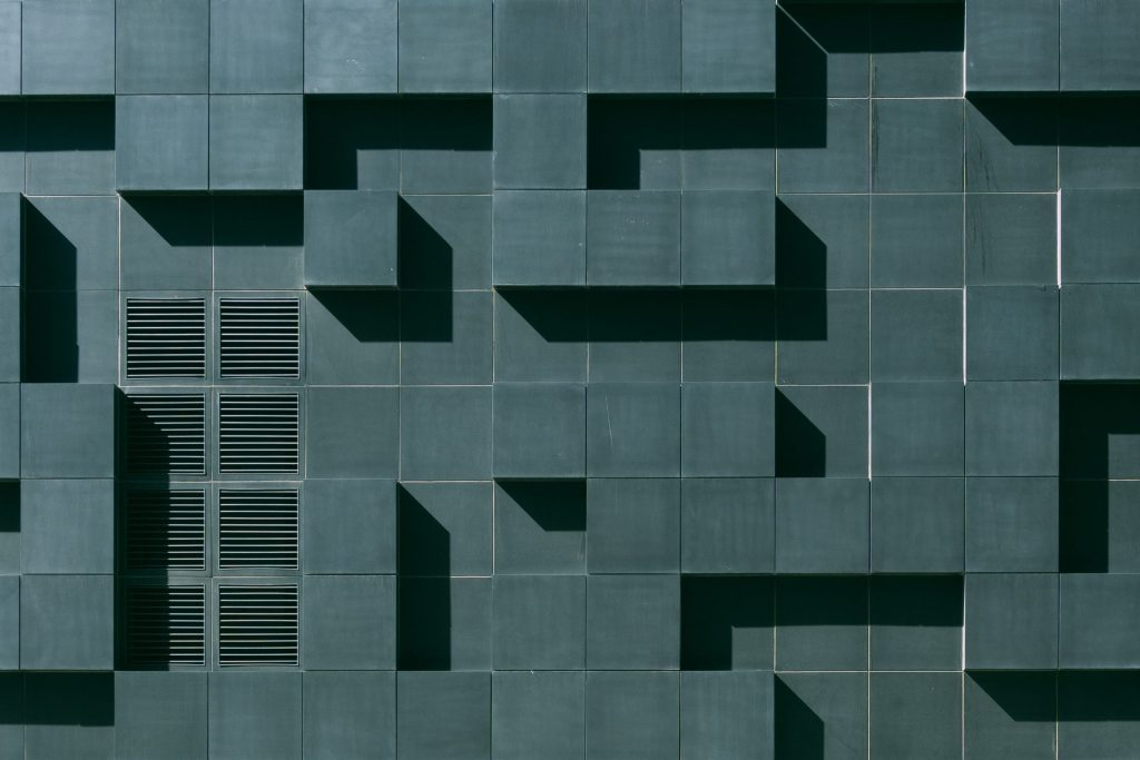 gray-concrete-building-exterior-with-geometric-design-3038740