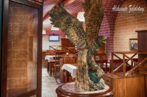 interior of the restaurant, an eagle made of wood