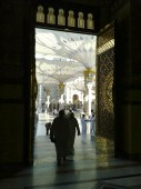 Masjid Al-Nabawi as seen from the inside out. Large umbrellas outside retract at night.