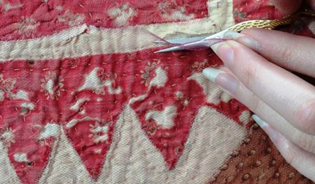 close up of a peice of sewn fabric being repaired