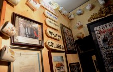 Civil rights memorabilia covers the walls of Linton's Barber Shop in Tuscaloosa. The shop itself is a civil rights landmark. (Karim Shamsi-Basha/Alabama NewsCenter)