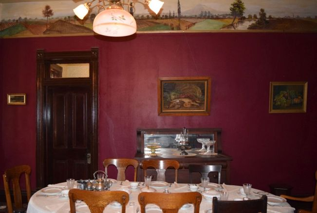 Students often dined at The Oaks, where low lighting protects frieze murals. (Donna Cope/Alabama NewsCenter)