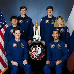 Five NASA astronauts and a Russian Cosmonaut take a break from training for their scheduled flight in space to pose for the traditional crew portrait. In the front (left to right) are Astronauts Kenneth S. Reightler Jr., and Charles F. Bolden Jr., pilot and commander, respectively. On middle row are Astronauts Franklin R. Chang-Diaz and N. Jan Davis, mission specialists. On back row are Astronaut Ronald M. Sega (left) and Russia's Sergei K. Krikalev, both mission specialists, 12/1/1993. (NASA)