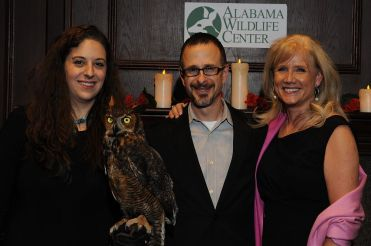 Scottie Jackson (l) with a Great Horned Owl Keith Feinman and Tine Hoffmeister. (Alabama Wildlife Center)