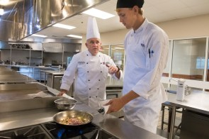 Sautéing is Duffett's favorite cooking method, practiced here with Jefferson State's Mitchell (left). (Phil Free/Alabama NewsCenter)