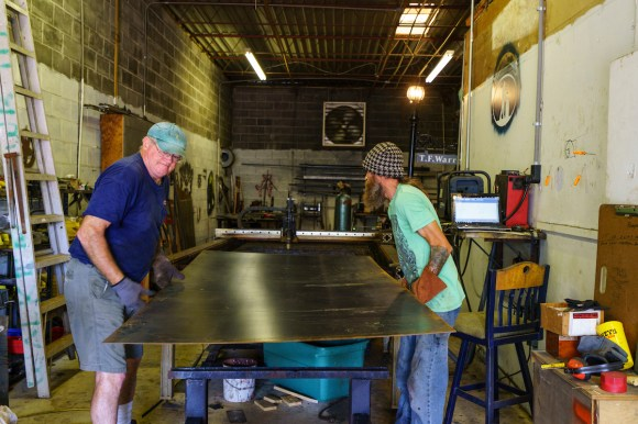 Alabama Iron Works uses a combination of high-tech and vintage tools to create its fire pits, signs and other ironwork. (Mark Sandlin / Alabama NewsCenter)