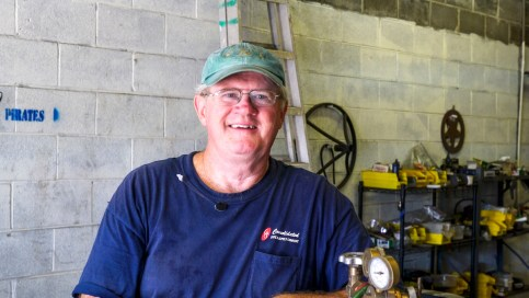Jim Trainer followed a career designing and building ships with a second act as a maker of personalized fire pits and signs. (Mark Sandlin / Alabama NewsCenter)